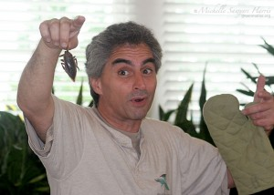 """Mark Berman holds up cooked giant water bug"""
